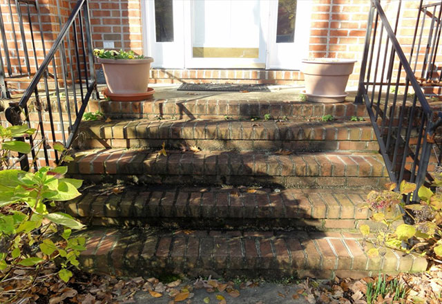 dirty brick stairs before